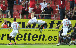 Photo -   Sevilla's Piotr Trochowski from Poland, center, reacts after scoring against Real Madrid during their La Liga soccer match at the Ramon Sanchez Pizjuan stadium, in Seville, Spain on Saturday, Sept. 15, 2012. Sevilla won the match 1-0. (AP Photo/Angel Fernandez)