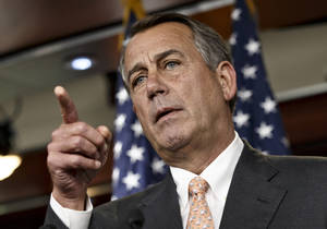 """Photo - Speaker of the House John Boehner is asked about the special select committee he has formed to investigate the deadly 2012 attack on the U.S. diplomatic post in Benghazi, Libya, raising the stakes in a political battle with the Obama administration as the midterm election season heats up, during a news conference on Capitol Hill in Washington, Thursday, May 8, 2014. The National Republican Congressional Committee has issued a fundraising pitch on its website asking people to become a """"Benghazi Watchdog"""" by donating money to GOP election efforts. Boehner has said that the examination would be """"all about getting to the truth"""" of the Obama administration's response to the attack and would not be a partisan, election-year circus. (AP Photo/J. Scott Applewhite)"""