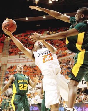 photo - OSU's James Anderson goes to the basket between Baylor's A.J. Walton, left, and Ekpe Udoh during the Cowboys' 82-75 win Saturday.  PHOTO BY BRYAN TERRY, THE OKLAHOMAN