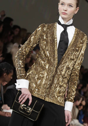Photo - This Feb. 16 photo shows fashion from the Fall 2012 collection of Ralph Lauren during Fashion Week in New York.   AP FILE Photo/Bebeto Matthews <strong>Bebeto Matthews - AP</strong>