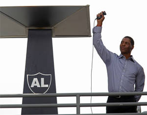 photo -   Former Oakland Raiders great Marcus Allen lights the eternal flame for the late Raiders owner Al Davis before an NFL football game between the Raiders and the Pittsburgh Steelers in Oakland, Calif., Sunday, Sept. 23, 2012. (AP Photo/Tony Avelar)