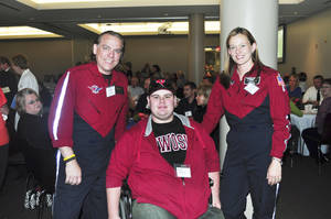 photo - Bryce Gannon, seated, is shown  with Todd Gilbert, EMT-P, and Deven Elliott, RN, both of EagleMed, his flight crew. Photo provided &lt;strong&gt;PROVIDED&lt;/strong&gt;