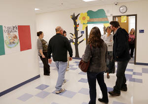 Photo - People visit during the open house at the renovated Boulevard Academy. Photo by Doug Hoke, The Oklahoman <strong>DOUG HOKE - THE OKLAHOMAN</strong>