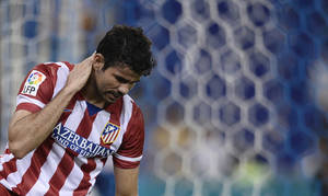 Photo - Atletico Madrid's Diego Costa, from Brazil, looks down during his team's Spanish La Liga soccer match against Espanyol at Cornella-El Prat stadium in Cornella Llobregat, Spain, Saturday, Oct. 19, 2013. (AP Photo/Manu Fernandez)