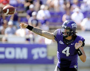 Photo - TCU quarterback Casey Pachall (4) throws a pass in the second quarter of an NCAA college football game against Portland State, Saturday, Sept. 24, 2011, in Fort Worth, Texas. TCU won 55-13. (AP Photo/Matt Strasen) ORG XMIT: TXMS112