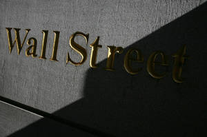 Photo - FILE - A sign for Wall Street is shown in this March 8, 2010 file photo near the New York Stock Exchange. Global stocks mostly rose Wednesday, July 23, 2014, bolstered by solid U.S. earnings and home sales as tensions between Russia and the West over Ukraine eased. (AP Photo/Mark Lennihan, File)