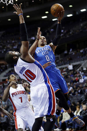 Photo - Oklahoma City Thunder guard Russell Westbrook (0) drives on Detroit Pistons center Greg Monroe (10) in the first half of an NBA basketball game in Auburn Hills, Mich., Monday, Nov. 12, 2012. (AP Photo/Paul Sancya) ORG XMIT: MIPS101