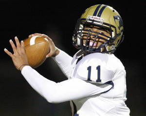 photo - Southmoore's Tre Edwards (11) passes the ball during a high school football game between Putnam City West and Southmoore at Putnam City Stadium in Oklahoma City, Thursday, Nov. 3, 2011. Photo by Nate Billings, The Oklahoman ORG XMIT: KOD