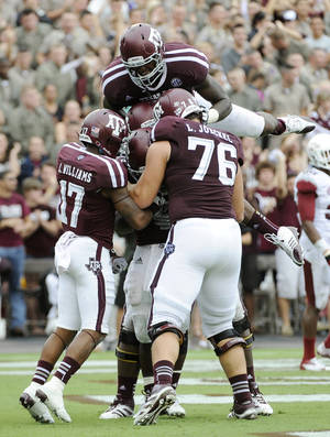 Photo -   Texas A&M players celebrate a touchdown against Arkansas during the third quarter of an NCAA college football game Saturday, Sept. 29, 2012, in College Station, Texas. A&M won 58-10. (AP Photo/Pat Sullivan)