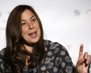 Photo - Current Wimbledon champion Marion Bartoli, of France, answers questions about her abrupt decision to retire from the tennis during a news conference at a hotel, Sunday, Aug. 25, 2013, in New York, one day before the beginning of the U.S. Open tennis tournament. (AP Photo/Kathy Willens)