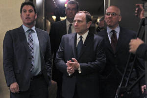 photo - NHL commissioner Gary Bettman, center, arrives to speak with reporters after an NHL Board of Governors meeting, Wednesday, Dec. 5, 2012 in New York.  The NHL and NHL Players' Association have cleared their schedules with progress being made in collective bargaining talks. (AP Photo/Mary Altaffer)