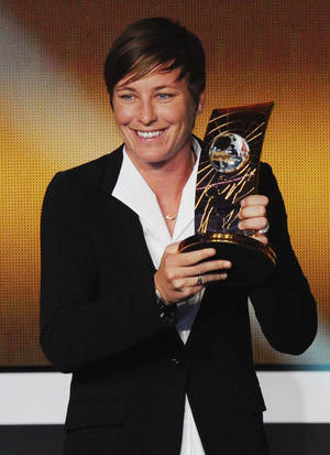 photo - Abby Wambach of the United States shows off the FIFA Women's World Player of the Year award during the FIFA Ballon d'Or Gala 2013 held at the Kongresshaus in Zurich, Switzerland, Monday, Jan. 7, 2013. (AP Photo/Keystone, Steffen Schmidt)