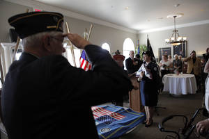 Photo - The presentation of the colors by Edmond North High School JROTC during an American Legion veterans ceremony at the Edmond Mansions retirement village in Edmond.  Photo by Garett Fisbeck, The Oklahoman <strong>GARETT FISBECK - GARETT FISBECK</strong>