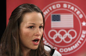 Photo - Ski-jumper Lindsey Van speaks with reporters during a news conference at the U.S. Olympic Committee media summit Tuesday, Oct. 1, 2013, in Park City, Utah. (AP Photo/Rick Bowmer)