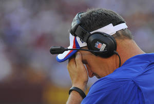 Photo - Buffalo Bills head coach Doug Marrone pauses during the second half of an NFL preseason football game against the Washington Redskins Saturday, Aug. 24, 2013, in Landover, Md. Washington won 30-7. (AP Photo/Richard Lipski)
