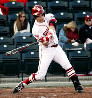 Photo - Matt Oberste hits as the University of Oklahoma (OU) Sooners play Hofstra in NCAA college baseball at L. Dale Mitchell Field on Friday, Feb. 15, 2013  in Norman, Okla. Photo by Steve Sisney, The Oklahoman