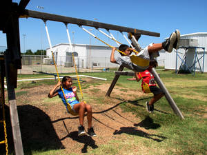 Photo - Students play at Bowlegs Elementary School during their summer vacation. Bowlegs school district is one of 10 in Seminole County. Photo by Li Lin,  The Oklahoman