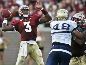 Photo - Florida State quarterback E.J. Manuel (3) gets a block as he throws against Charleston Southern in the second quarter of an NCAA college football game on Saturday, Sept. 10, 2011, in Tallahassee, Fla. (AP Photo/Phil Sears) ORG XMIT: FLPS109