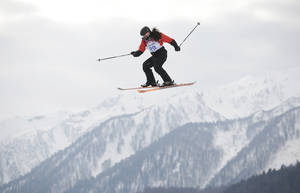 Photo - Paraguay's Julia Marino takes a jump during the women's freestyle skiing slopestyle qualifying at the Rosa Khutor Extreme Park, at the 2014 Winter Olympics, Tuesday, Feb. 11, 2014, in Krasnaya Polyana, Russia. (AP Photo/Jae C. Hong)