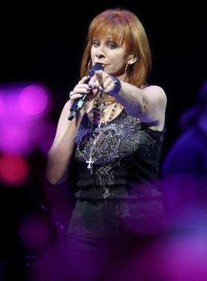 Photo - Reba McEntire performs during a concert at the Oklahoma City Arena on Saturday, Jan. 15, 2011. Photo by Bryan Terry, The Oklahoman ORG XMIT: KOD