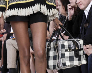 Photo -   Fashion from the Spring 2013 collection of Tory Burch is modeled during New York fashion week on Tuesday, Sept. 11, 2012 in New York. (AP Photo/Bebeto Matthews)