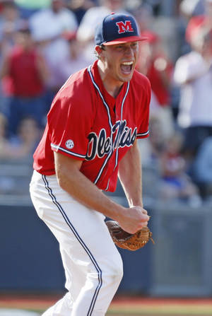 Photo - Mississippi pitcher Aaron Greenwood celebrates his closing out of the eighth inning without giving up a run to Washington during an NCAA college baseball regional tournament game in Oxford, Miss., Sunday, June 1, 2014. Mississippi won 2-1. (AP Photo/Rogelio V. Solis)
