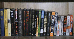 Photo -   This 2011 photo provided by the U.S. Attorney's office shows a shelf containing books about gangsters and crime in the Santa Monica, Calif., apartment where Whitey Bulger and Catherine Greig hid before their arrest in June 2011. The photo was among hundreds of documents unsealed by prosecutors Friday, June 15, 2012, three days after Greig was sentenced in Boston to eight years in prison for helping Bulger during his years as a fugitive. (AP Photo/U.S. Attorney's Office)