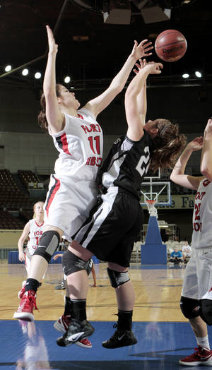 Photo - Fort Gibson Lady Tigers Savannah Gray (11) fights Perkins-Tryon Lady Demon's Hanna Runner (24) for the ball as they play the in the Oklahoma State Class 4A Girls Basketball Tournament at the Fairgrounds Arena on Friday, March 9, 2012, in Oklahoma City, Okla.     Photo by Steve Sisney, The Oklahoman