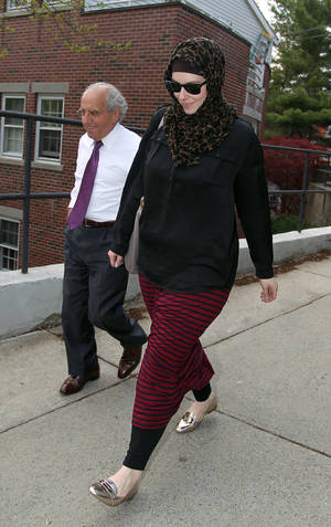 Photo - FILE - In this April 29, 2013 file photo, Katherine Russell, wife of Boston Marathon bomber suspect Tamerlan Tsarnaev, right, leaves the law office of DeLuca and Weizenbaum with Amato DeLuca, in Providence, R.I. Relatives of Tsarnaev, the older of the brothers suspected in the Boston Marathon bombing, will claim his body now that his wife has agreed to release it, an uncle said as officials in the U.S. and Russia deepened their investigations into him. (AP Photo/Stew Milne, File)