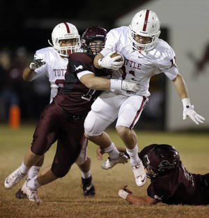 Photo - Tuttle's Jesse Gregory is tackled by Blanchard's Logan Wright during the high school football game between Blanchard and Tuttle in Blanchard,Okla.,  Friday, Nov. 8, 2013. Photo by Sarah Phipps, The Oklahoman