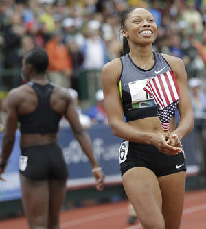 Photo -   Allyson Felix, right, celebrates her win in the women's 200 meters at the U.S. Olympic Track and Field Trials Saturday, June 30, 2012, in Eugene, Ore. Felix won the 200 but she and Jeneba Tarmoh, walking off at left rear, tied for third place in the 100 meters. (AP Photo/Marcio Jose Sanchez)