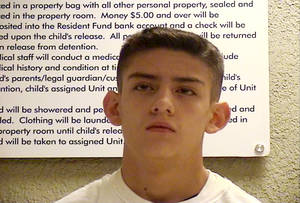 photo - Nehemiah Griego, 15,  is seen in an undated photo provided by the Bernalillo County Sheriff's Deptartment. Griego is charged with killing five family members on Jan. 19, 2013, including his father, mother, and three youngest siblings in Albuquerque, N.M.  Authorities in New Mexico say Griego had reloaded his guns after the attacks and planned to go to a Wal-Mart and randomly shoot people. Instead, they say he texted a picture of his dead mother to his 12-year-old girlfriend, then spent much of Saturday with her. The two went to the church where his father had been a pastor, and Griego eventually confessed to killing his parents and three younger siblings.  (AP Photo/Bernalillo County Sheriff's Deptartment)