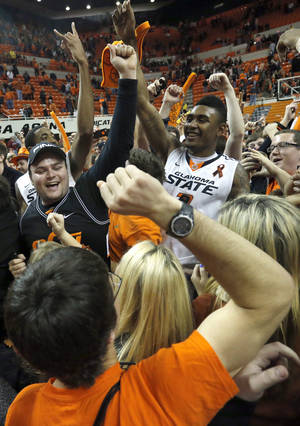 photo - Oklahoma State's Le'Bryan Nash (2) celebrates following the Bedlam men's college basketball game between the Oklahoma State University Cowboys and the University of Oklahoma Sooners at Gallagher-Iba Arena in Stillwater, Okla., Saturday, Feb. 16, 2013. Photo by Sarah Phipps, The Oklahoman