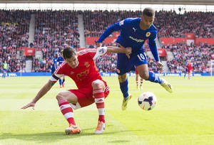 Photo - Southampton's Dejan Lovren, left, in action with Cardiff City's Fraizer Campbell during their English Premier League soccer match at St Mary's, Southampton, England, Saturday April 12, 2014. (AP Photo/PA, Chris Ison) UNITED KINGDOM OUT  NO SALES  NO ARCHIVE