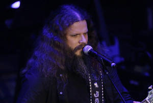 "Photo - Jamey Johnson performs during the 2011 Academy of Country Music Honors show in Nashville, Tenn. Johnson pays tribute to Hank Cochran with the release this week of ""Living for a Song: A Tribute to Hank Cochran,"" a deep look at the songwriter's career. AP Photo"