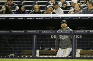 Photo -   New York Yankees' Alex Rodriguez watches from the bench in the ninth inning of Game 1 of the American League championship series against the Detroit Tigers Saturday, Oct. 13, 2012, in New York. (AP Photo/Matt Slocum)