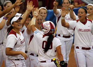 Photo - Sooners celebrate a run by Oklahoma's Destinee Martinez as the University of Oklahoma Sooner (OU) softball team plays Tennessee in the first game of the NCAA super regional at Marita Hynes Field on May 23, 2014 in Norman, Okla. Photo by Steve Sisney, The Oklahoman