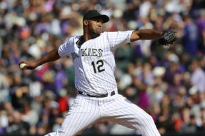 Photo - Colorado Rockies starting pitcher Juan nicasio works against the Arizona Diamondbacks in the fourth inning of a baseball game in Denver on Friday, April 4, 2014. (AP Photo/David Zalubowski)