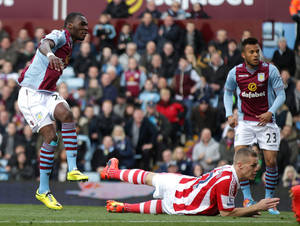 Photo - Aston Villa's Christian Benteke, left, scores his teams opening goal during their English Premier League soccer match against Stoke City at Villa Park, Birmingham, England, Sunday, March 23, 2014. (AP Photo/Nick Potts, PA Wire)    UNITED KINGDOM OUT    -    NO SALES   -   NO ARCHIVES