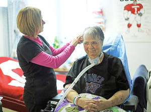 photo - Misti Peterson fixes her mother, Glenda Kay Hutchison's, hair in Hutchison's room at Kindred Hospital in  Oklahoma City. Photo by SARAH PHIPPS, the Oklahoman