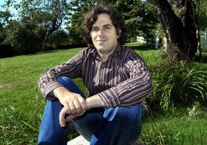 """Photo - FILE - This Sept. 2005 file photo shows Jonathan Lethem, author of """"Fortress of Solitude,"""" outside his summer home in Blue Hill, Maine. A musical based on Jonathan Lethem's celebrated 2003 novel """"The Fortress of Solitude"""" is heading toward New York. The Public Theater said Monday, March 4, 2013, that it will co-produce the show and bring it to its downtown home for the 2014-15 season after it debuts at the Dallas Theater Center in March. (AP Photo/Pat Wellenbach, file)"""