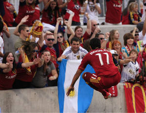 Photo -   Real Salt Lake midfielder Javier Morales (11) leaps in the air as he hurdles a barricade to celebrate with fans after scoring against the Portland Timbers in the first half of an MLS soccer game, Saturday, Sept. 22, 2012, in Sandy, Utah. (AP Photo/Rick Bowmer)