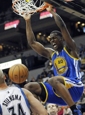 Photo -   Golden State Warriors' Harrison Barnes dunks in the second half of an NBA basketball game against the Minnesota Timberwolves, Friday, Nov. 16, 2012, in Minneapolis. The Warriors won 106-98. Barnes and David Lee each scored game highs of 18 points. (AP Photo/Jim Mone)