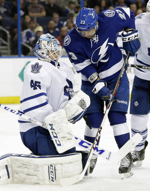 Photo - Toronto Maple Leafs goalie Jonathan Bernier (45) makes a save on a shot by Tampa Bay Lightning right wing J.T. Brown (23) during the second period of an NHL hockey game, Thursday, Feb. 6, 2014, in Tampa, Fla. (AP Photo/Chris O'Meara)