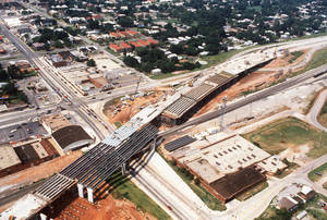 Photo - Construction on the elevated section of Centennial Expressway (Interstate 235) is seen as it goes over NE 23 just east of Broadway Avenue, in this photo from 1987. View is looking northwest. The highway changed and quieted residential neighborhoods in the area north of downtown. The Oklahoman archives
