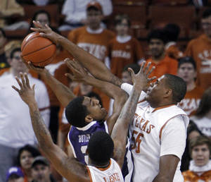 Photo - TCU's Nate Butler Lind has his shot stopped by Texas' Cameron Ridley during the first half of an NCAA college basketball game, Saturday, Feb. 2, 2013, in Austin, Texas. (AP Photo/Michael Thomas)