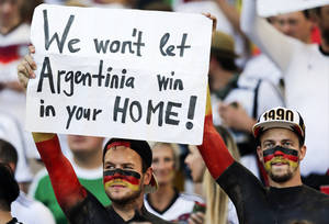 Photo - German supporters hold up a banner before the World Cup final soccer match between Germany and Argentina at the Maracana Stadium in Rio de Janeiro, Brazil, Sunday, July 13, 2014. (AP Photo/Matthias Schrader)