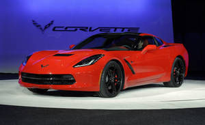 Photo - FILE - In this Monday, Jan. 14, 2013, file photo, the 2014 Chevrolet Corvette Stingray is revealed at media previews for the North American International Auto Show in Detroit. Maybe it was the brand new, bright red Chevrolet Corvette gleaming in one corner, or the elegant BMW coupe in the other, but car companies were positively giddy this week as the North American International Auto Show opened in Detroit. U.S. new car and truck sales reached a five-year high of 14.5 million in 2012, and many executives and analysts think they'll climb to 15.5 million this year. (AP Photo/Paul Sancya, file)