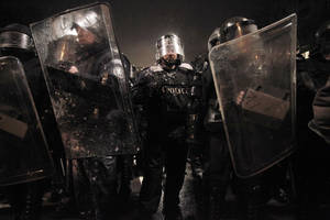 photo - Riot police form up after clashes with demonstrators after  a protest against high electricity prices in Sofia, on late Tuesday, Feb. 19, 2013.  Bulgaria's prime minister announced on Tuesday that the license held by a Czech company for power distribution in parts of the Balkan country will be revoked following protests against high electricity prices. (AP Photo/Valentina Petrova)