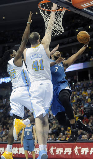 photo - Denver Nuggets forward Kenneth Faried, left, and center Kosta Koufos, center, defend the rim against Minnesota Timberwolves forward Derrick Williams, right, in the first quarter of an NBA basketball game on Saturday, March 9, 2013, in Denver. (AP Photo/Chris Schneider)